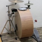 Sideways drum kit with the snare drum integrated in the bass drum shell